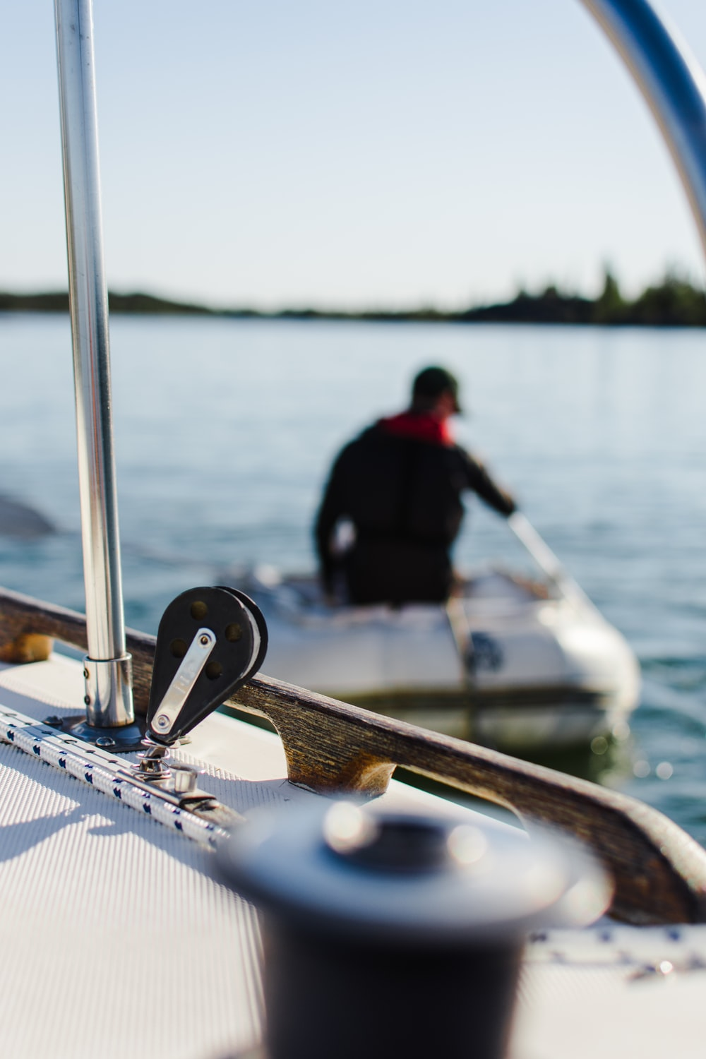 shallow focus photography of man sitting riding boat