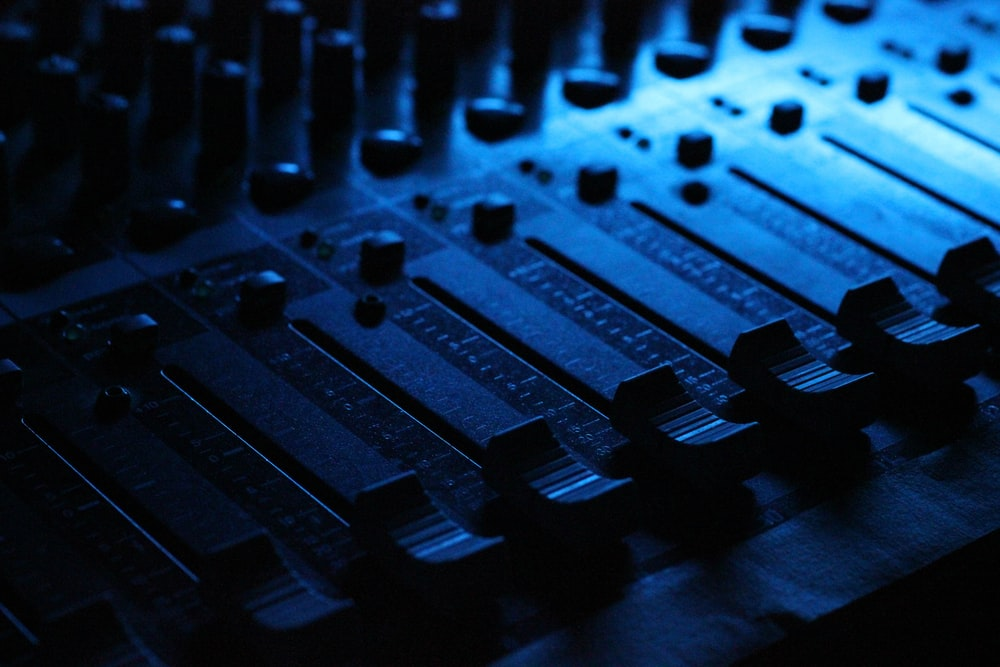 shallow focus photography of audio mixer