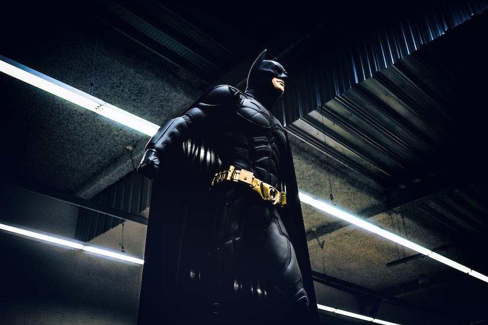 Batman standing under steel roof
