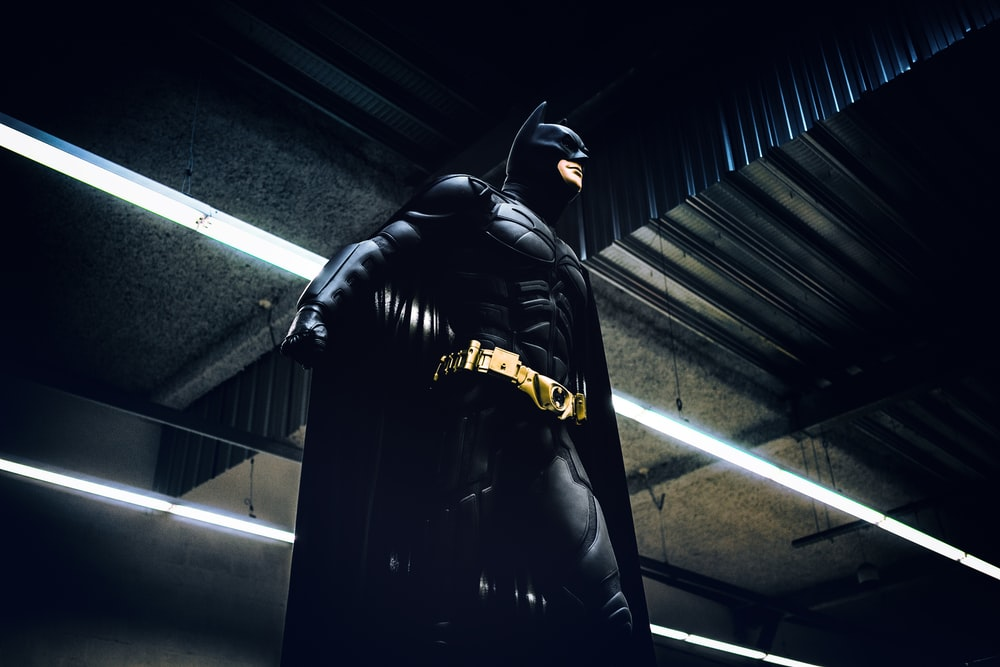 Batman standing under steel roof
