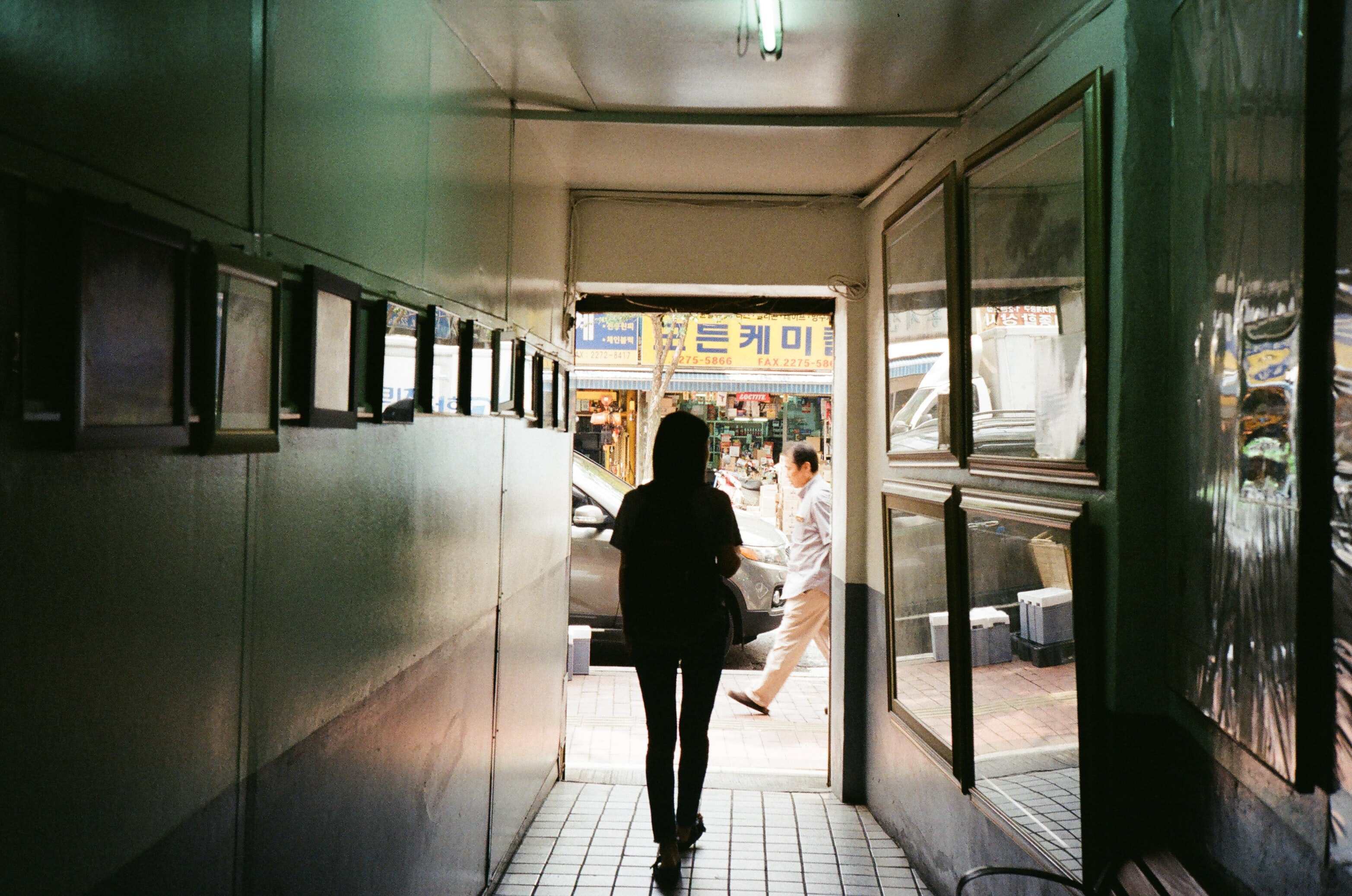 silhouette of a woman walking at the corridor