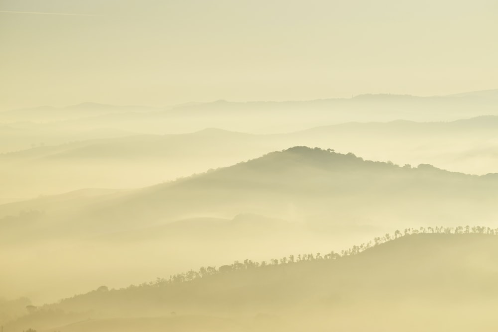 landscape photography of mountains during foggy day