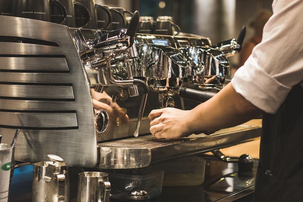 person using espresso machine