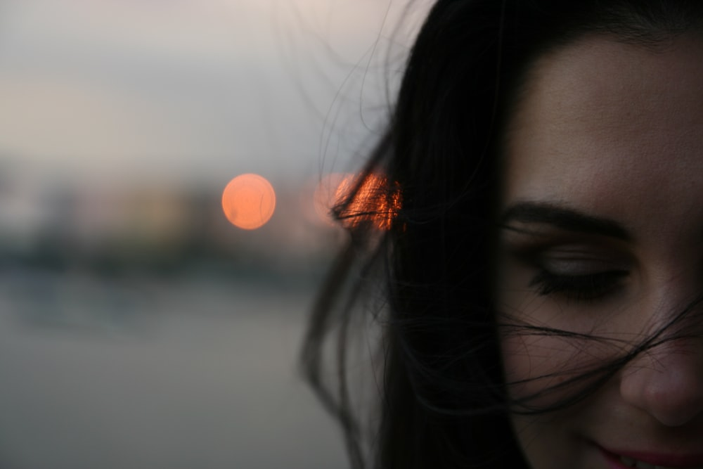 smiling woman with bokeh background