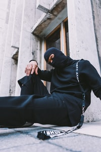 man in black long-sleeved shirt sitting on floor
