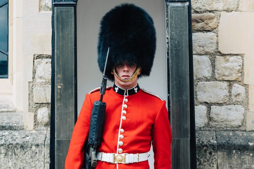 guard standing near brown wall