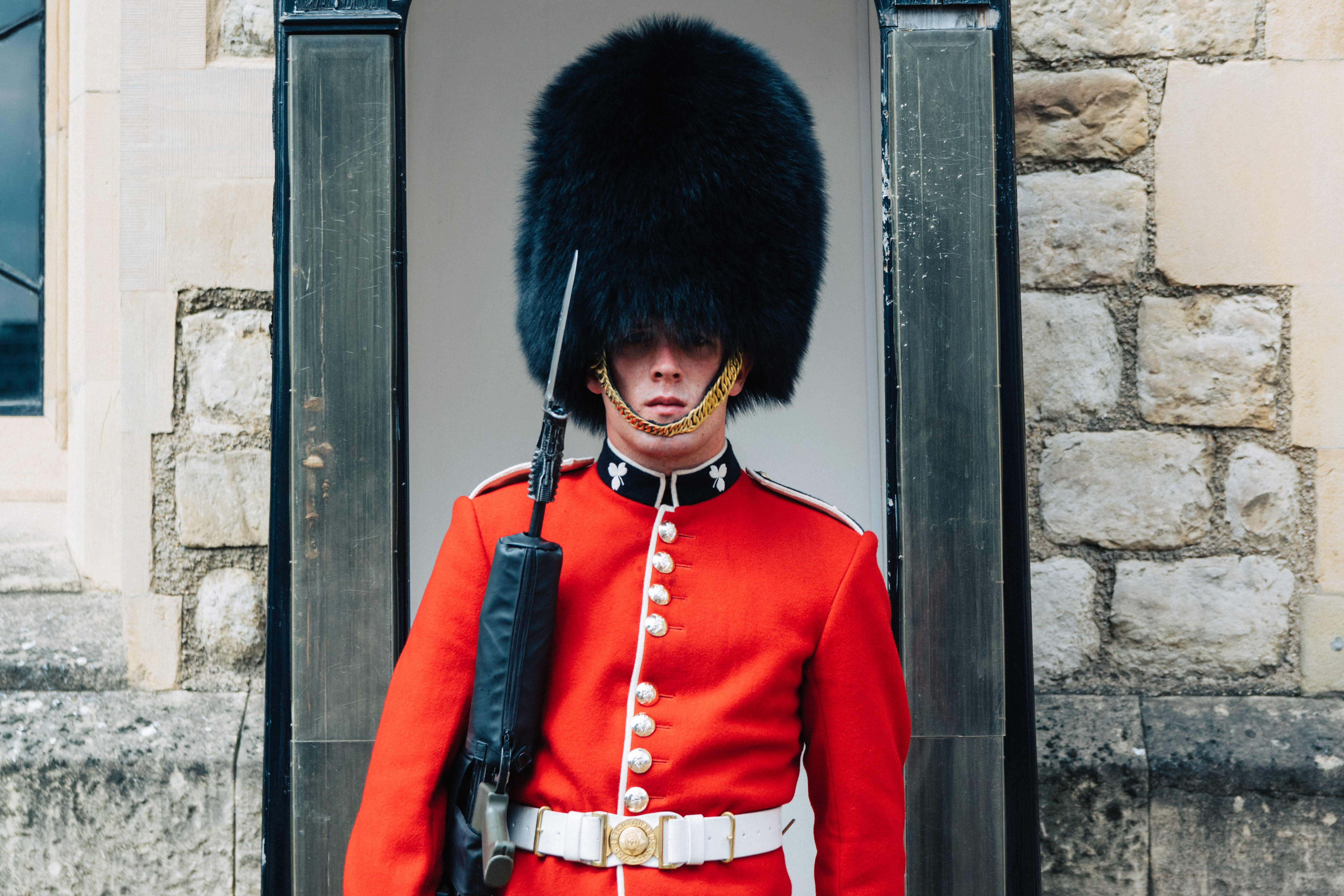 guard standing near brown wall