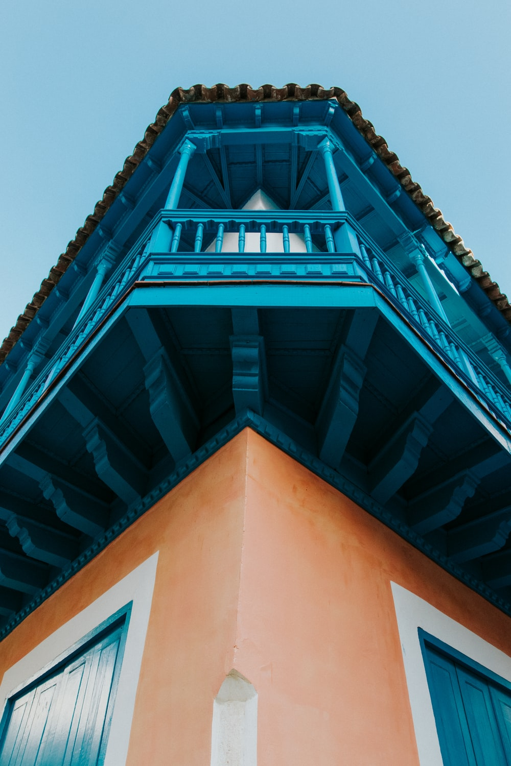 brown and blue two-storey building