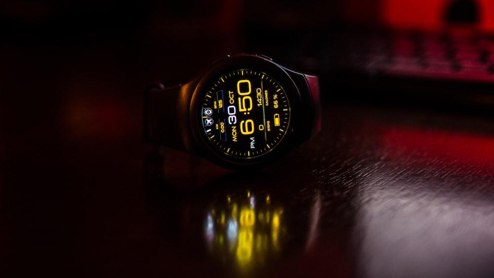 round black digital watch at 6:50