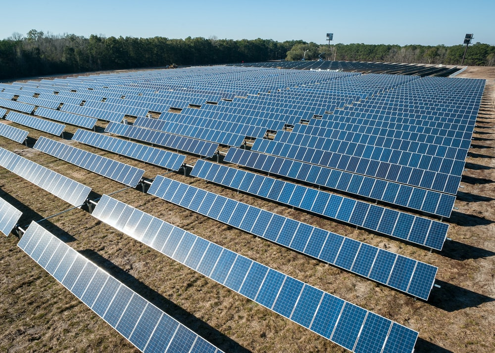 solar panel boards on brown ground
