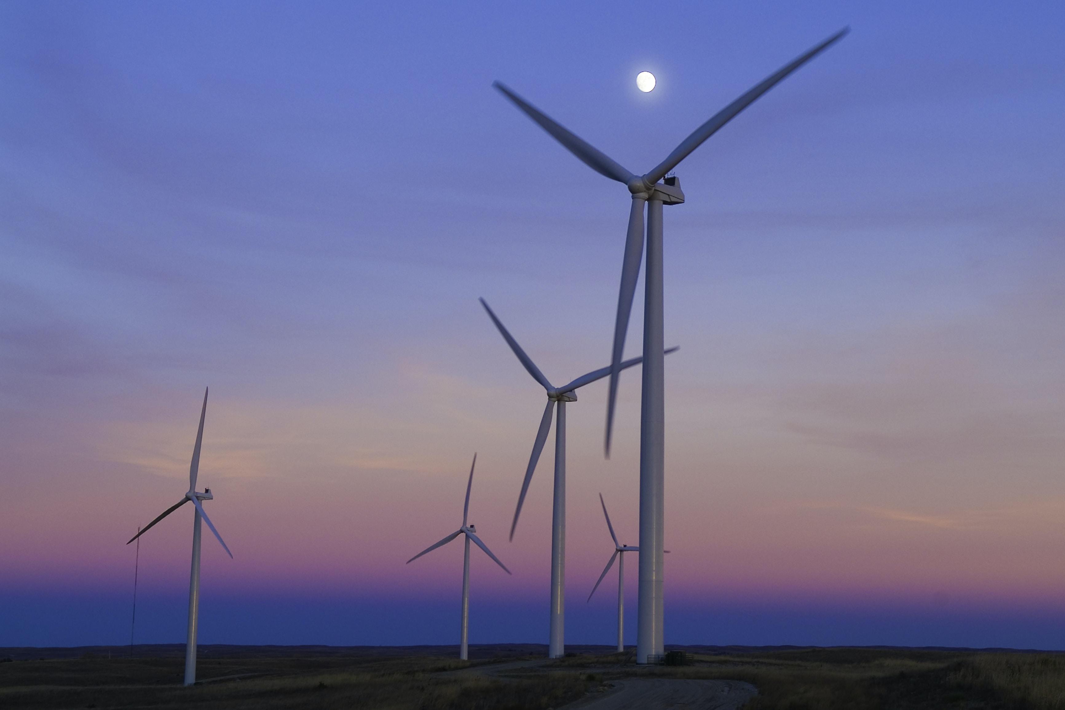 five windmills in front of ocean