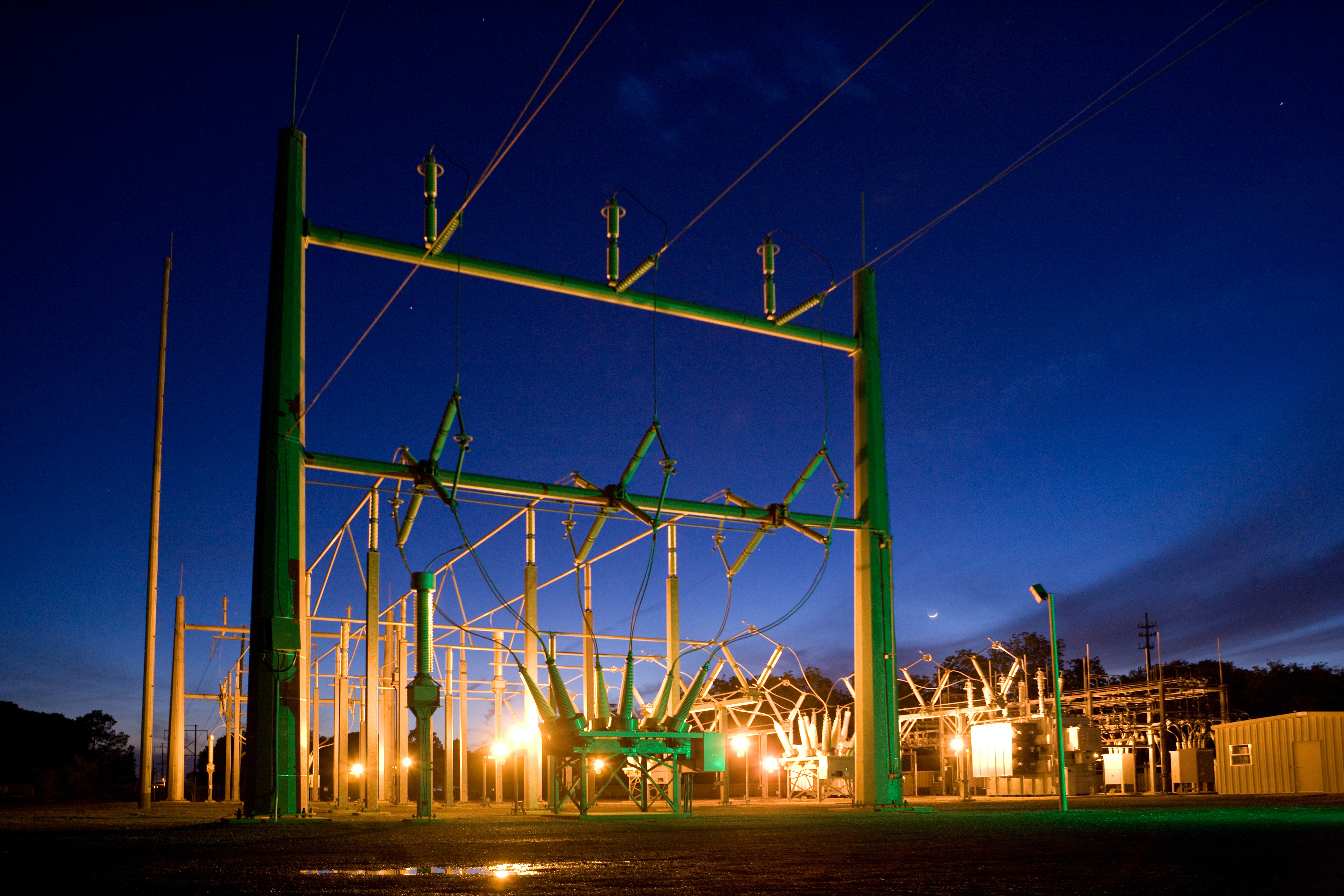 green and grey transmission tower during nighttime