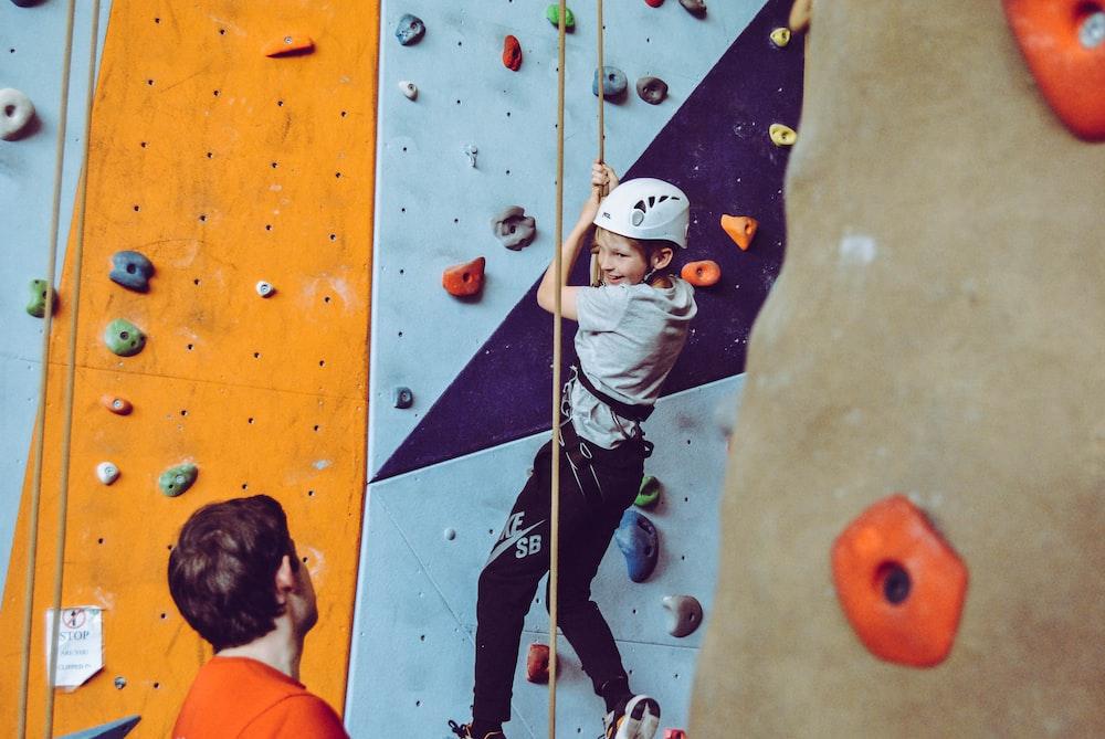 boy doing wall climbing