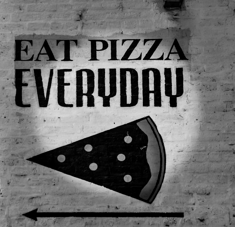 grayscale photo of eat pizza everyday signage