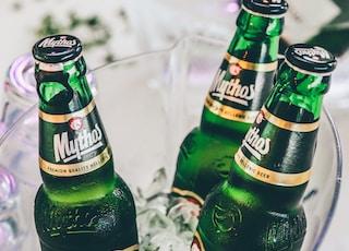 three green beer glass bottles