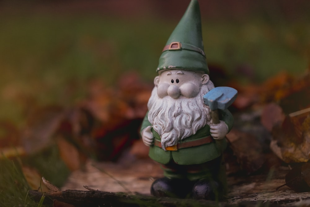 shallow focus photography of dwarf figurine