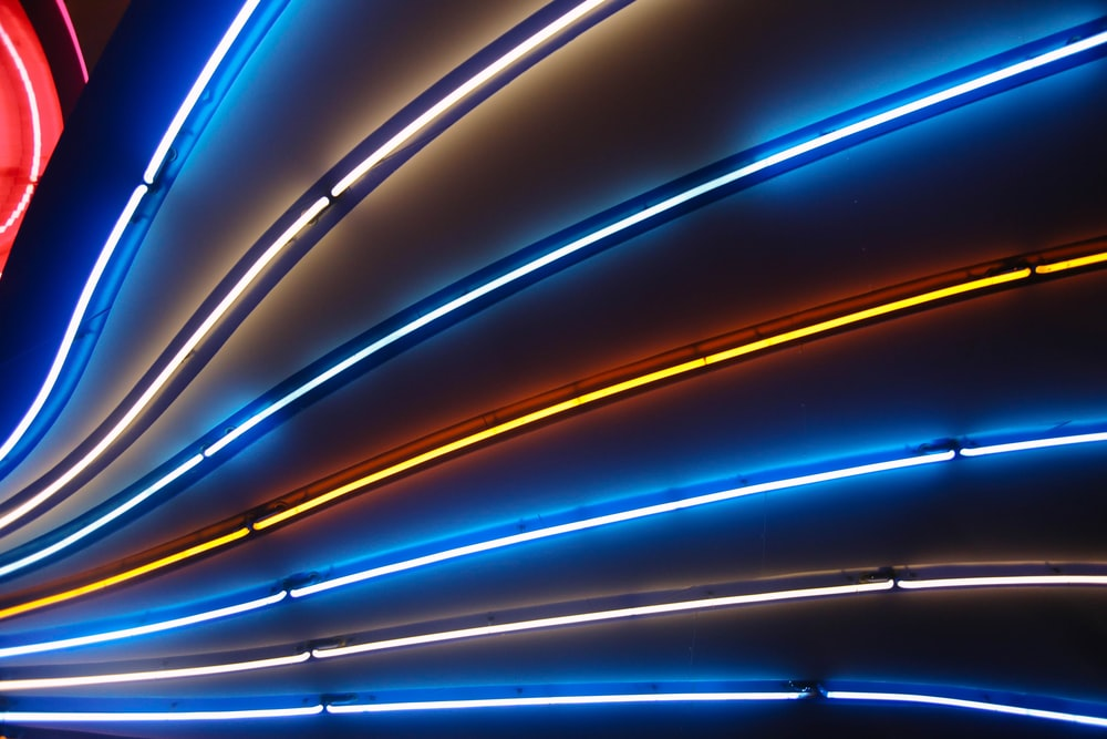 blue and yellow neon light signage