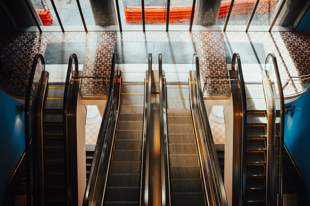 four gray escalators