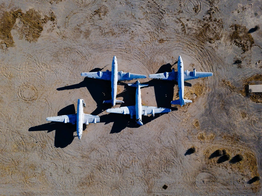 bird's-eye view photography of four white airliners