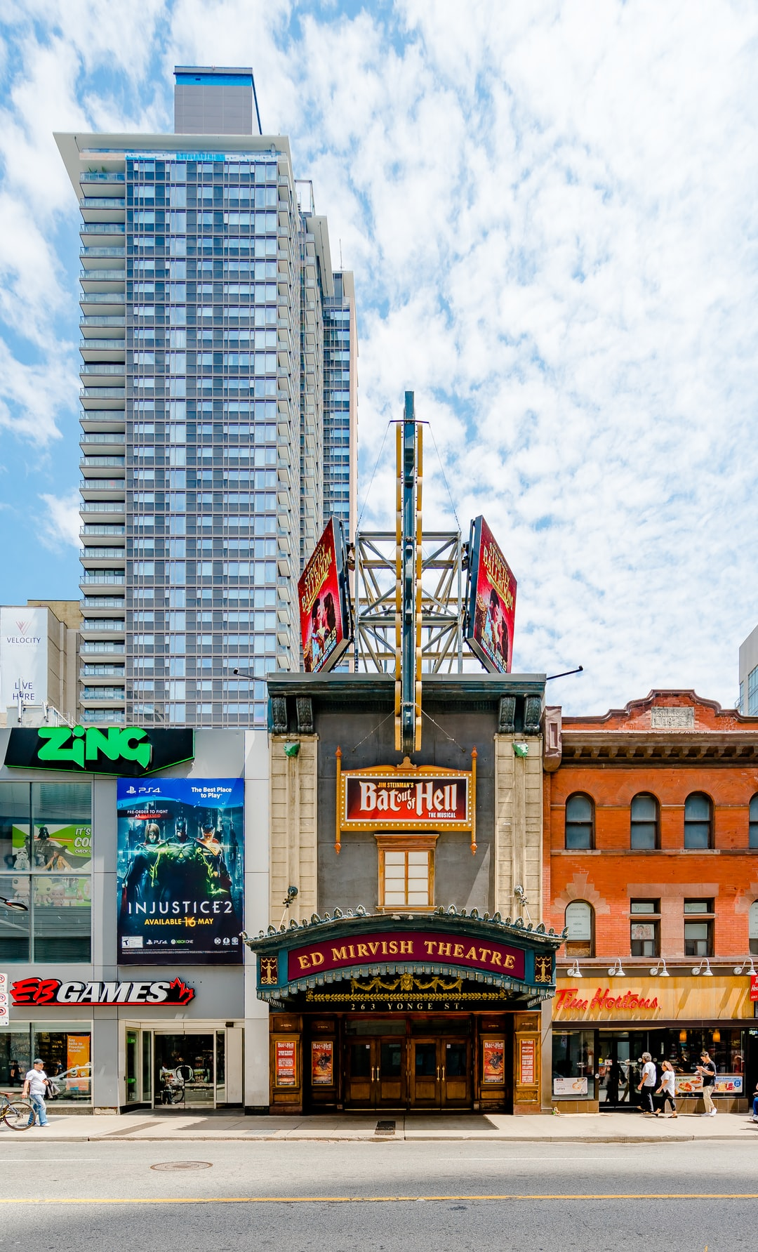 A verticle streetscape featuring Ed Mirvish Theatre on Yonge Street in Toronto