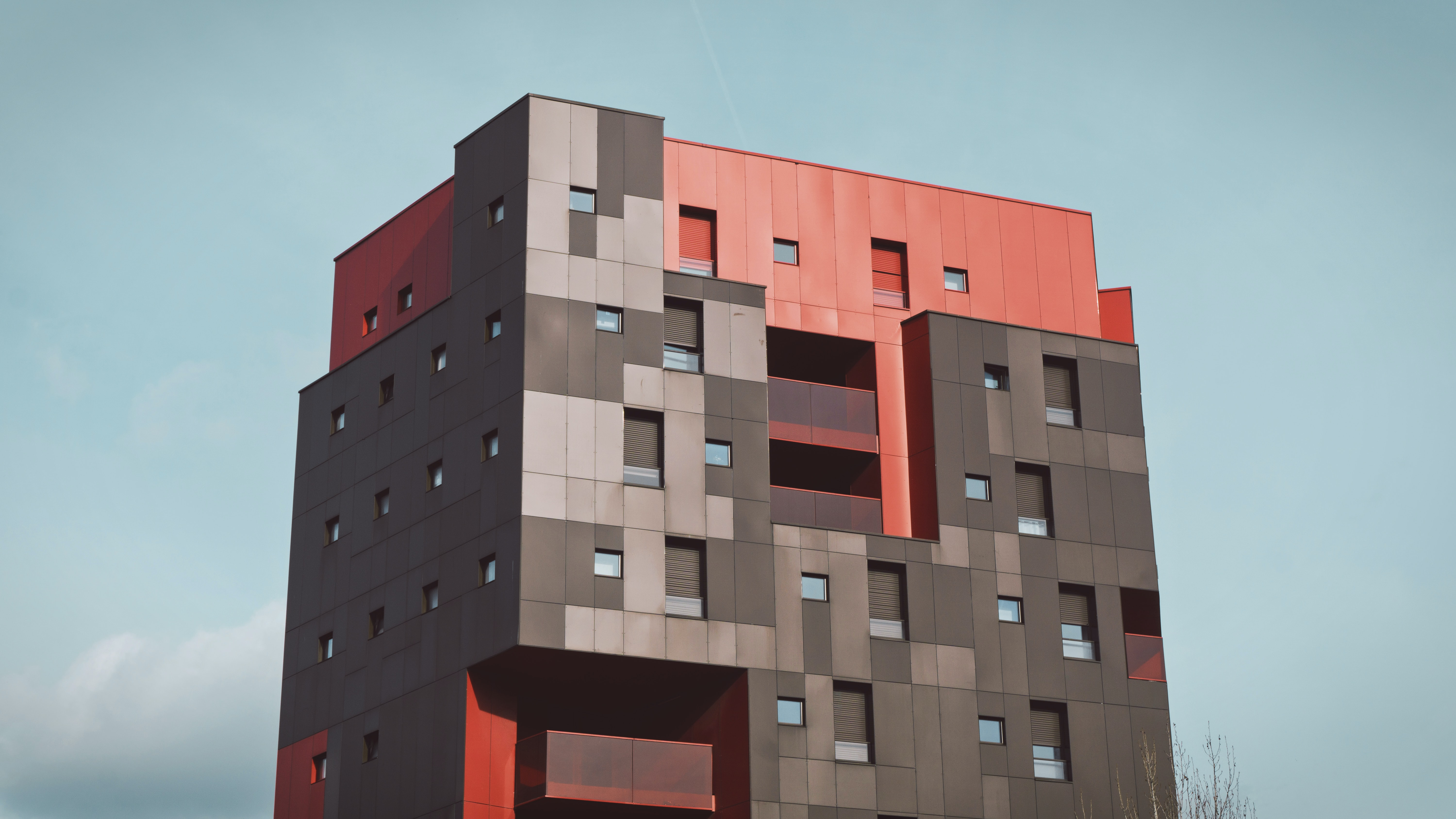 grey and red 3D model of multi storey building