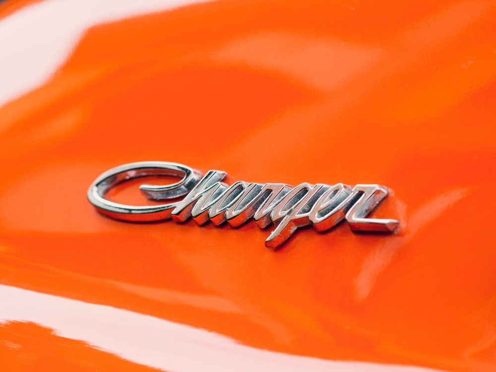 orange Dodge Charger close-up photography