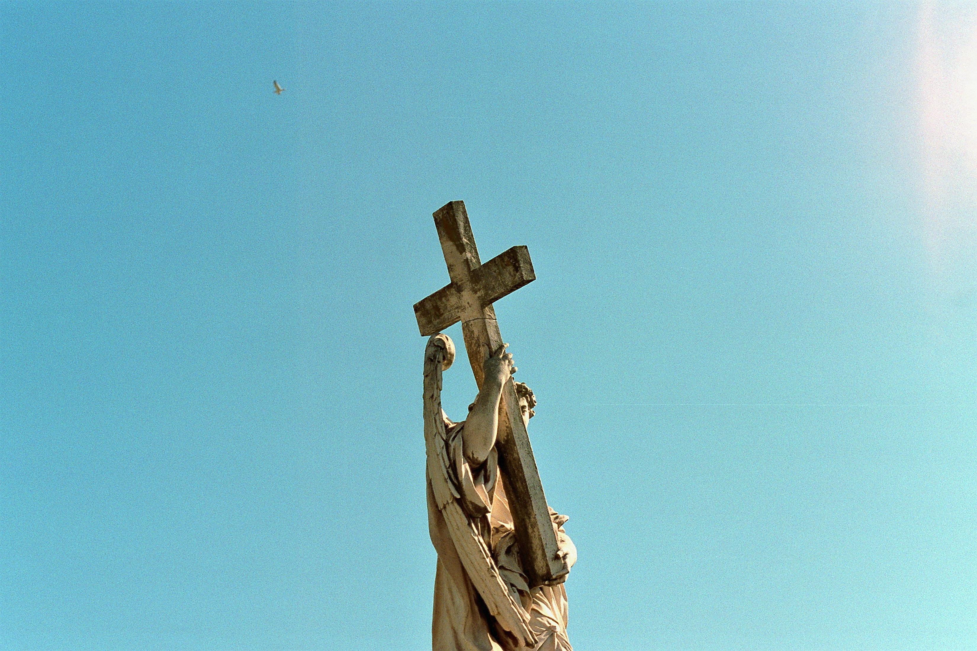 angel holding cross monument