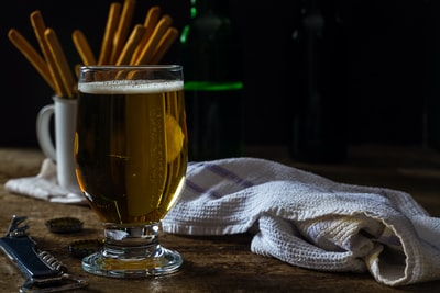 clear footed glass beside white textile cider zoom background