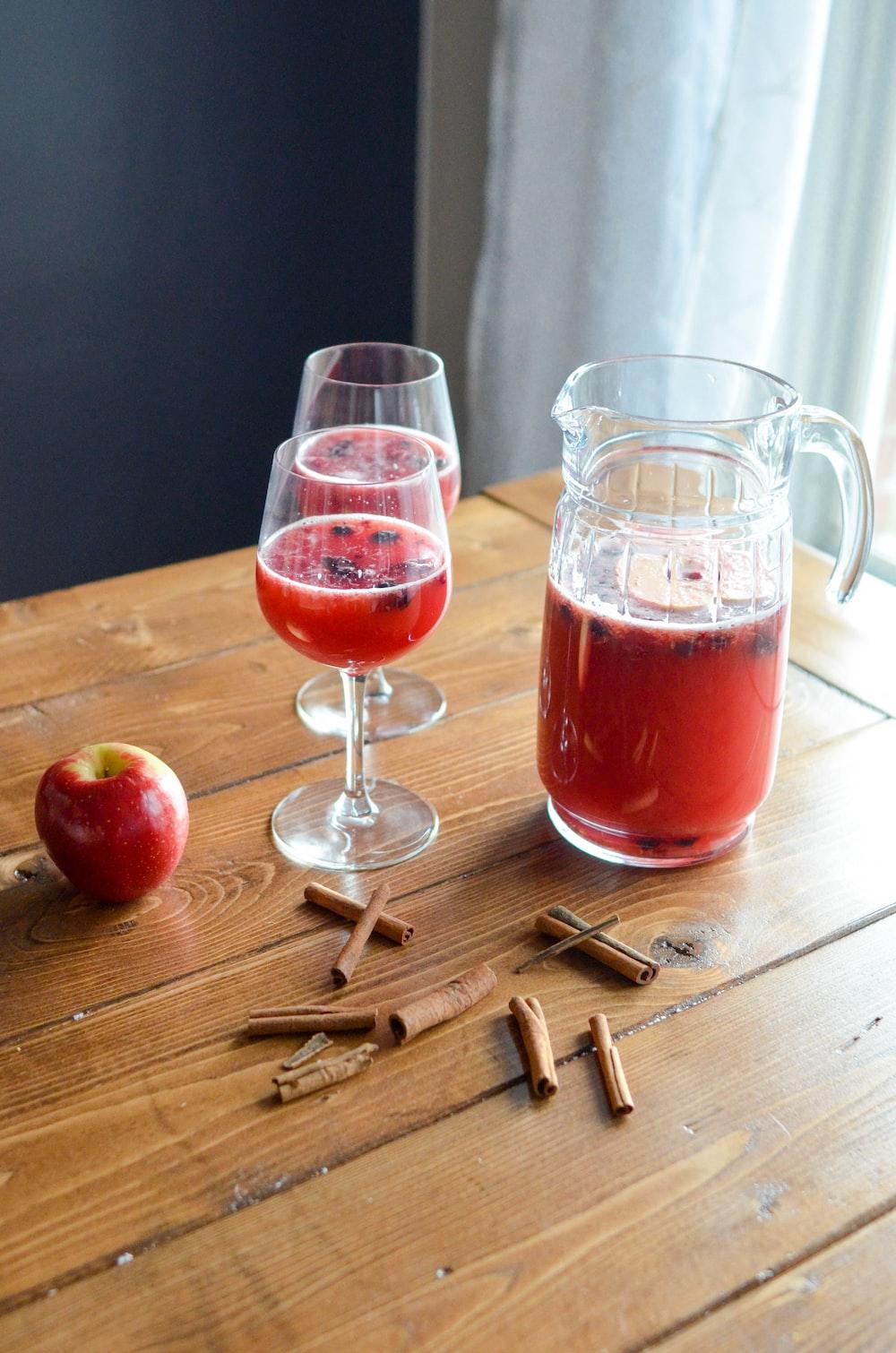 apple juice beside cinnamon