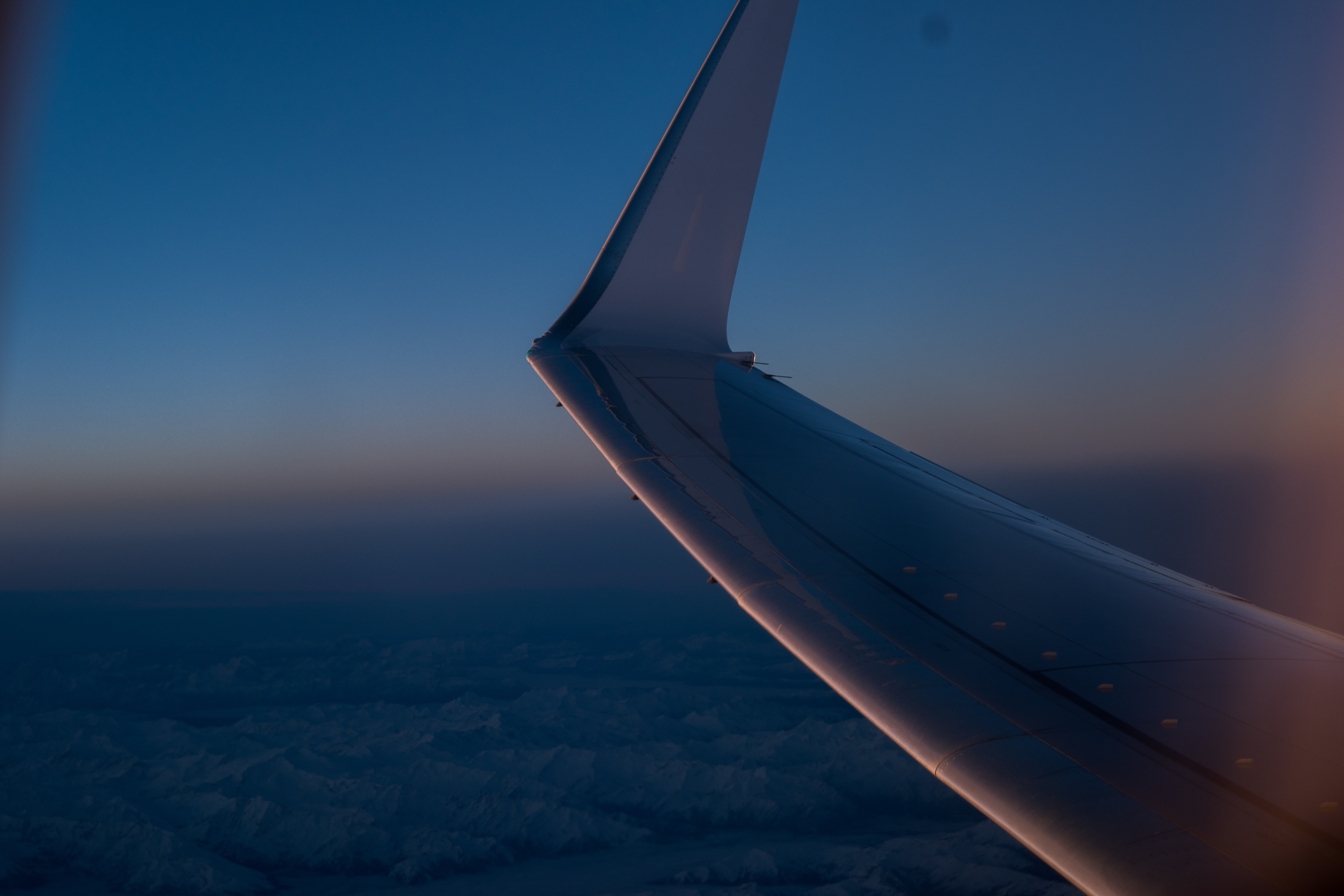 shallow focus photography of view inside plane