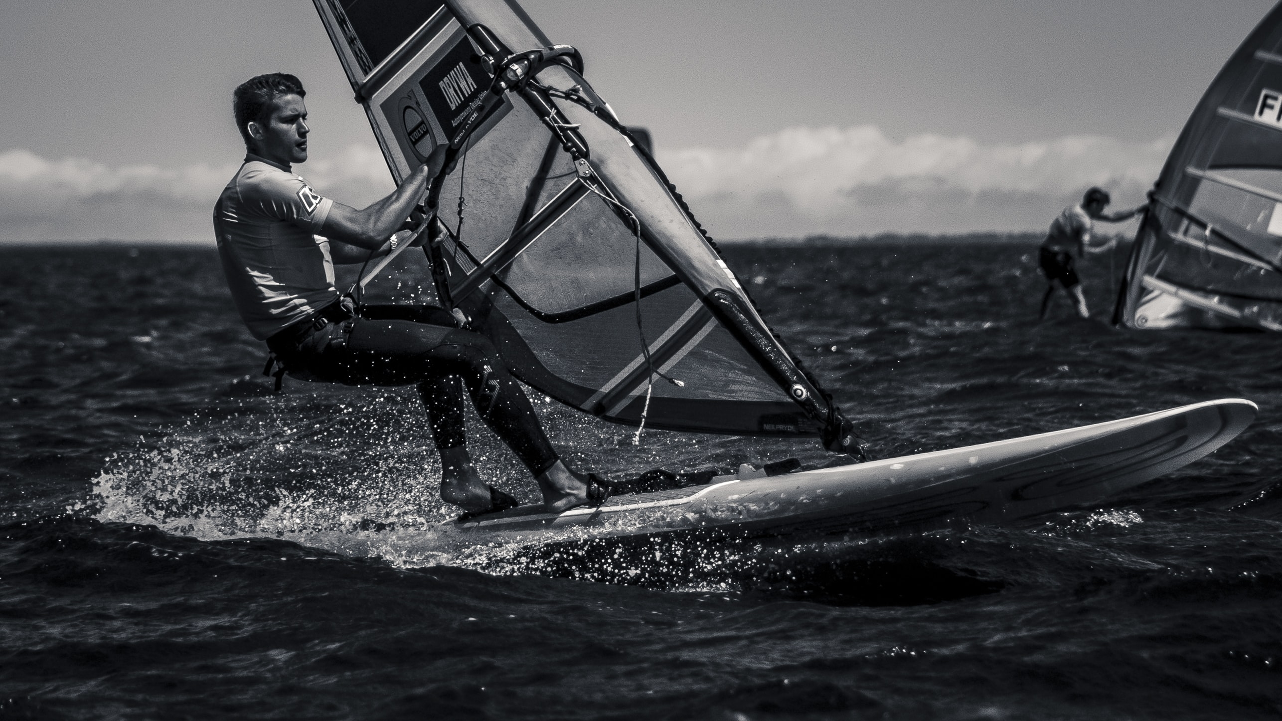 man riding surfboard with sail