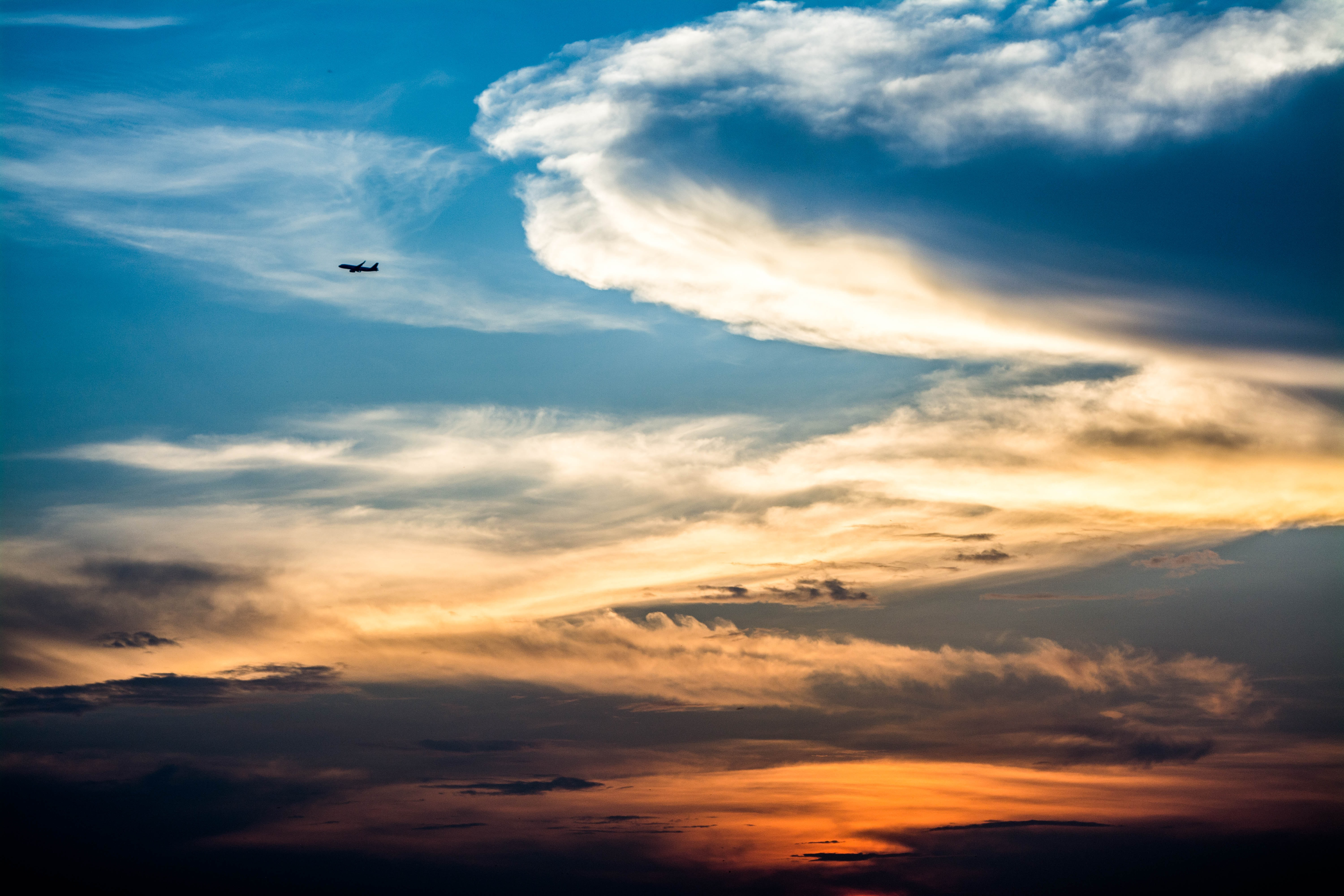 low-angle photography of airplane on golden hour