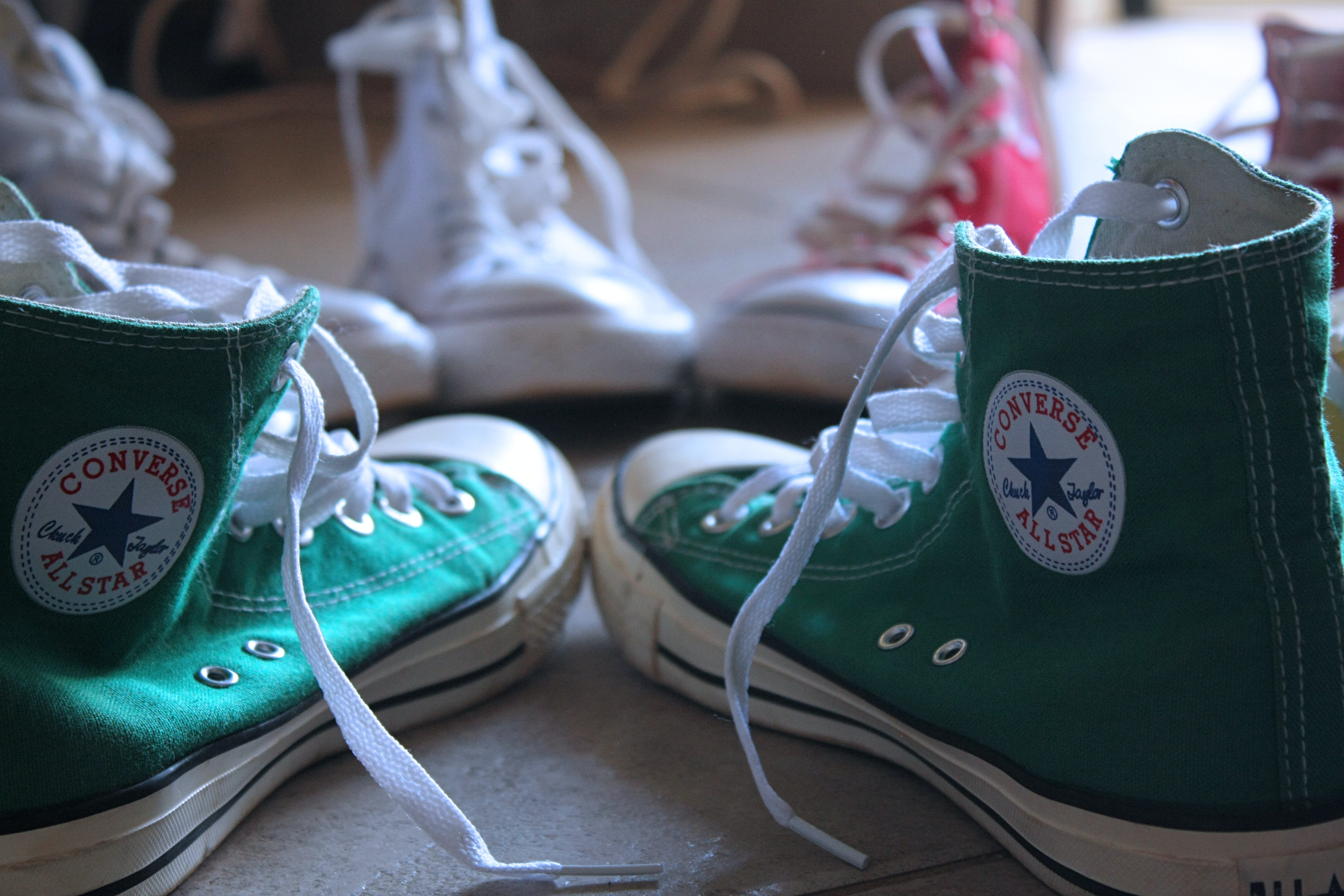 closeup photo of green Converse high-top sneakers
