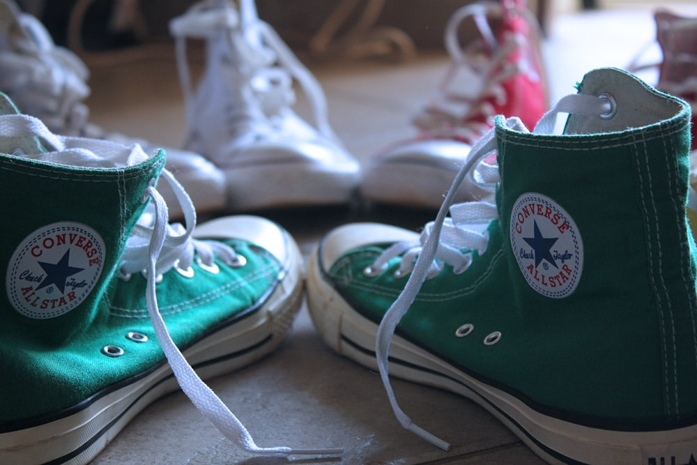 closeup photo of green Converse high-top sneakers