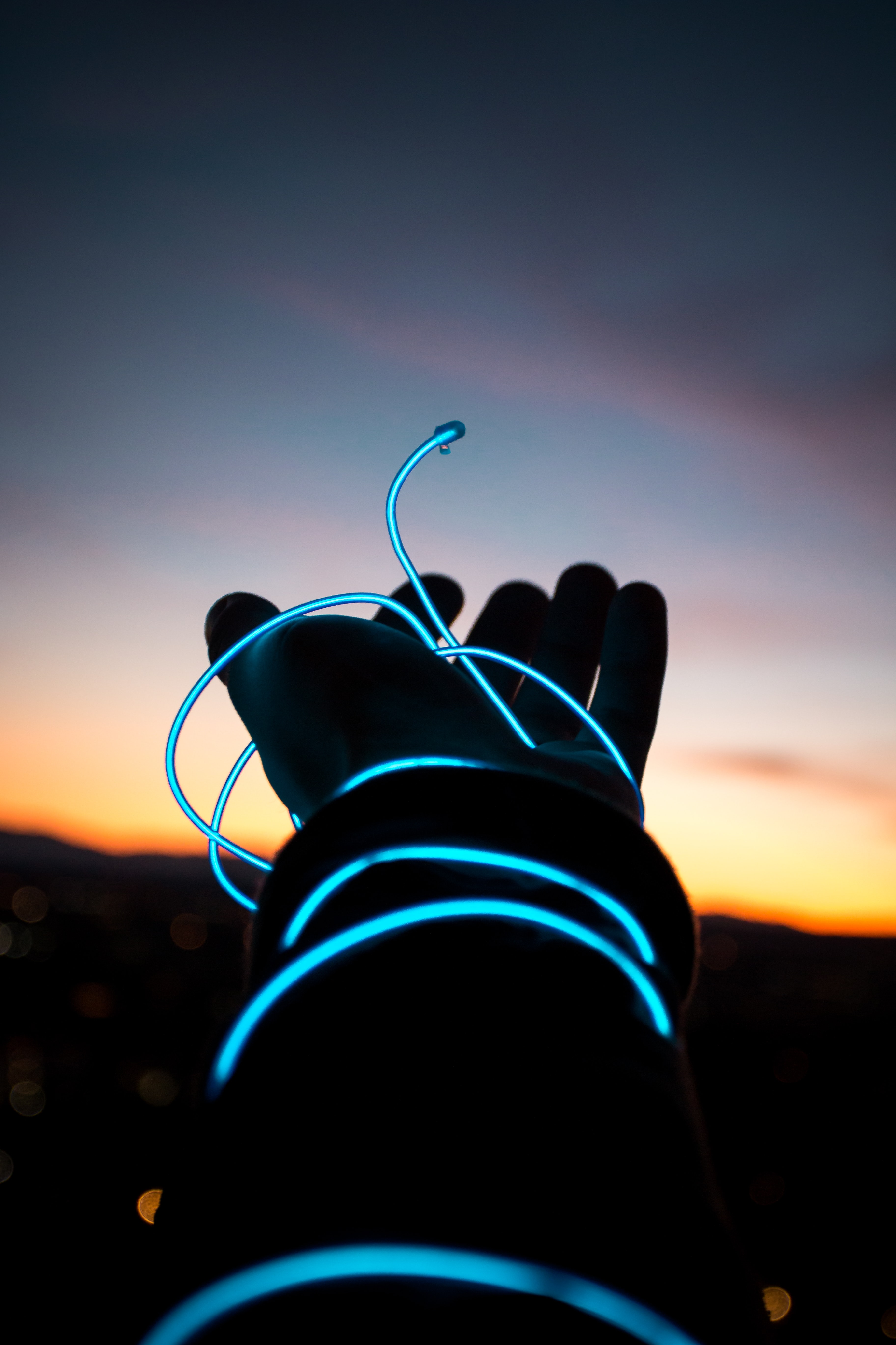 blue light wire on person's left hand