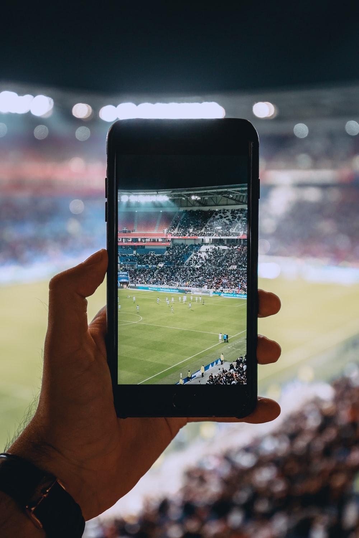 person taking photo using black smartphone