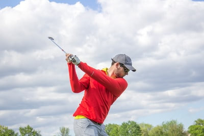 man holding golf club masters golf tournament zoom background
