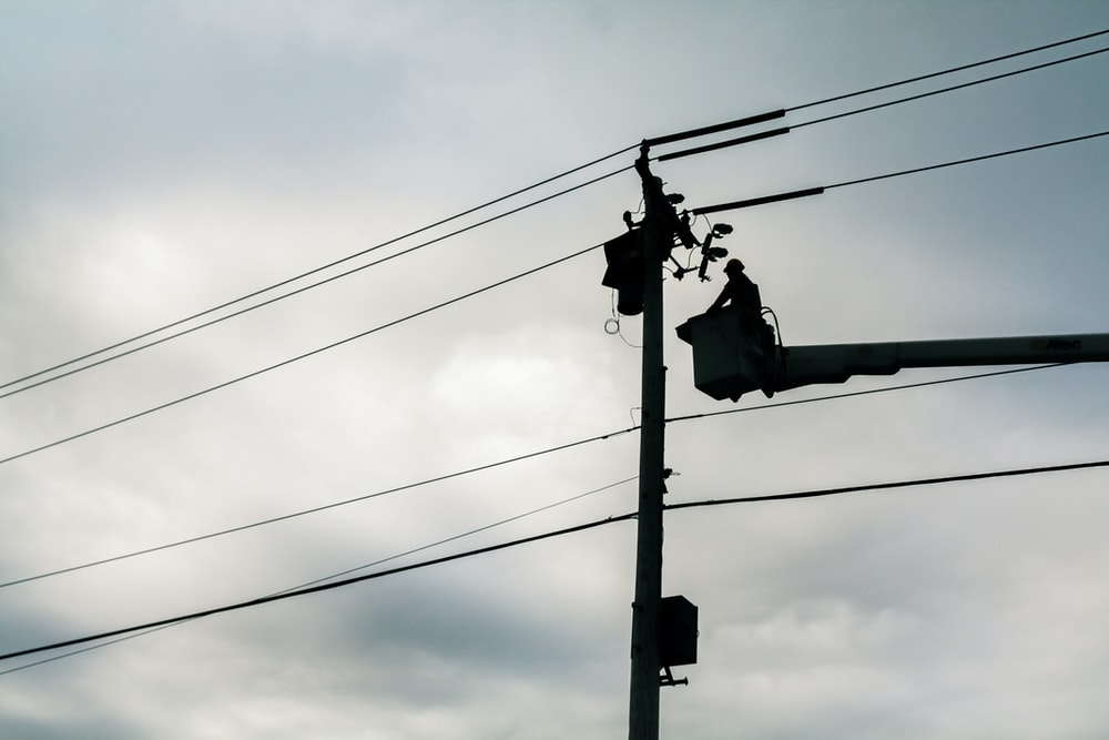 silhouette of street lamp during daytime