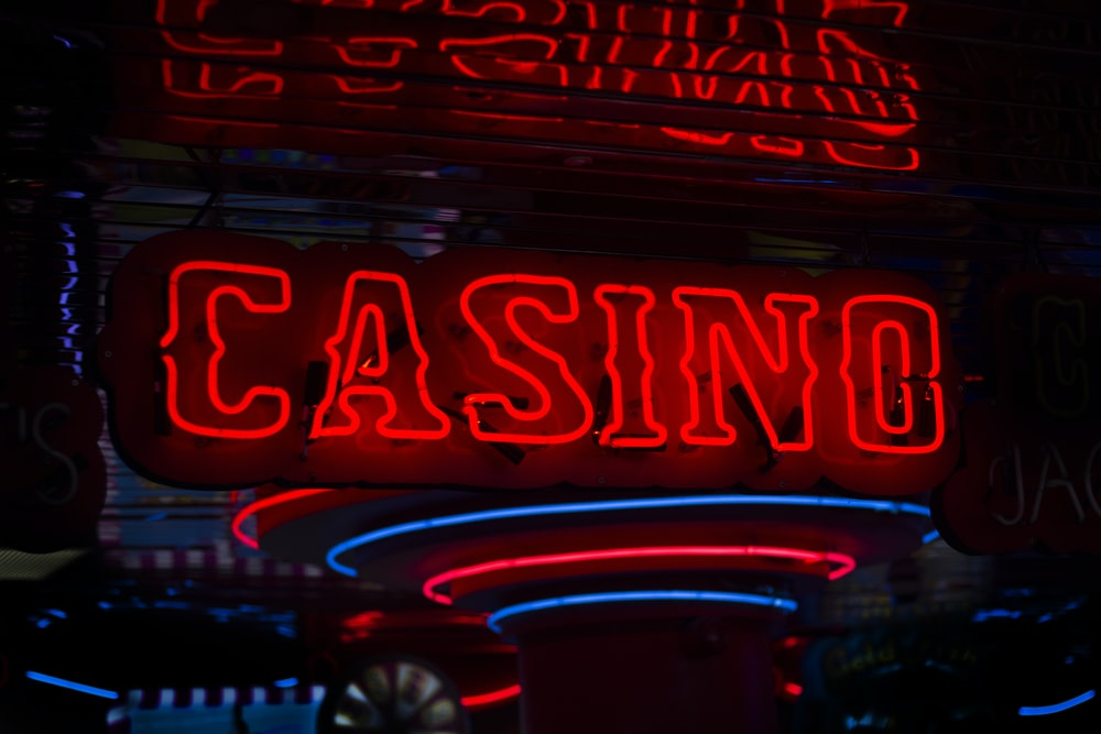 red Casino neon sign turned on comeon casino review