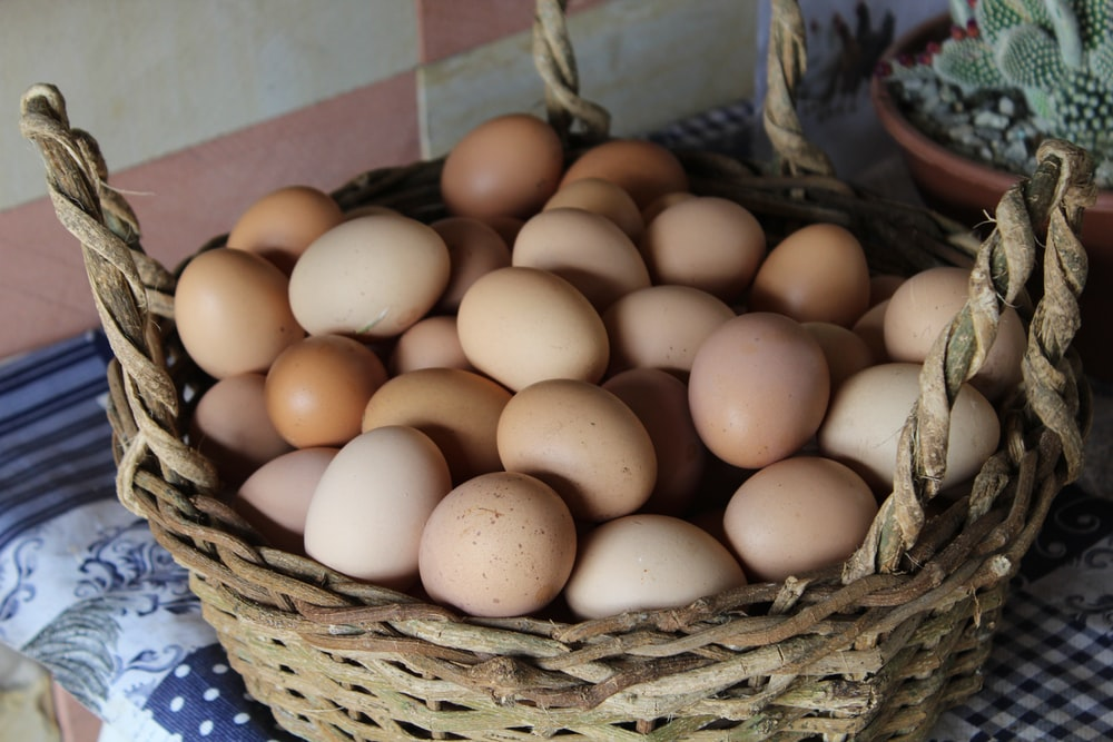 eggs in brown wicker basket