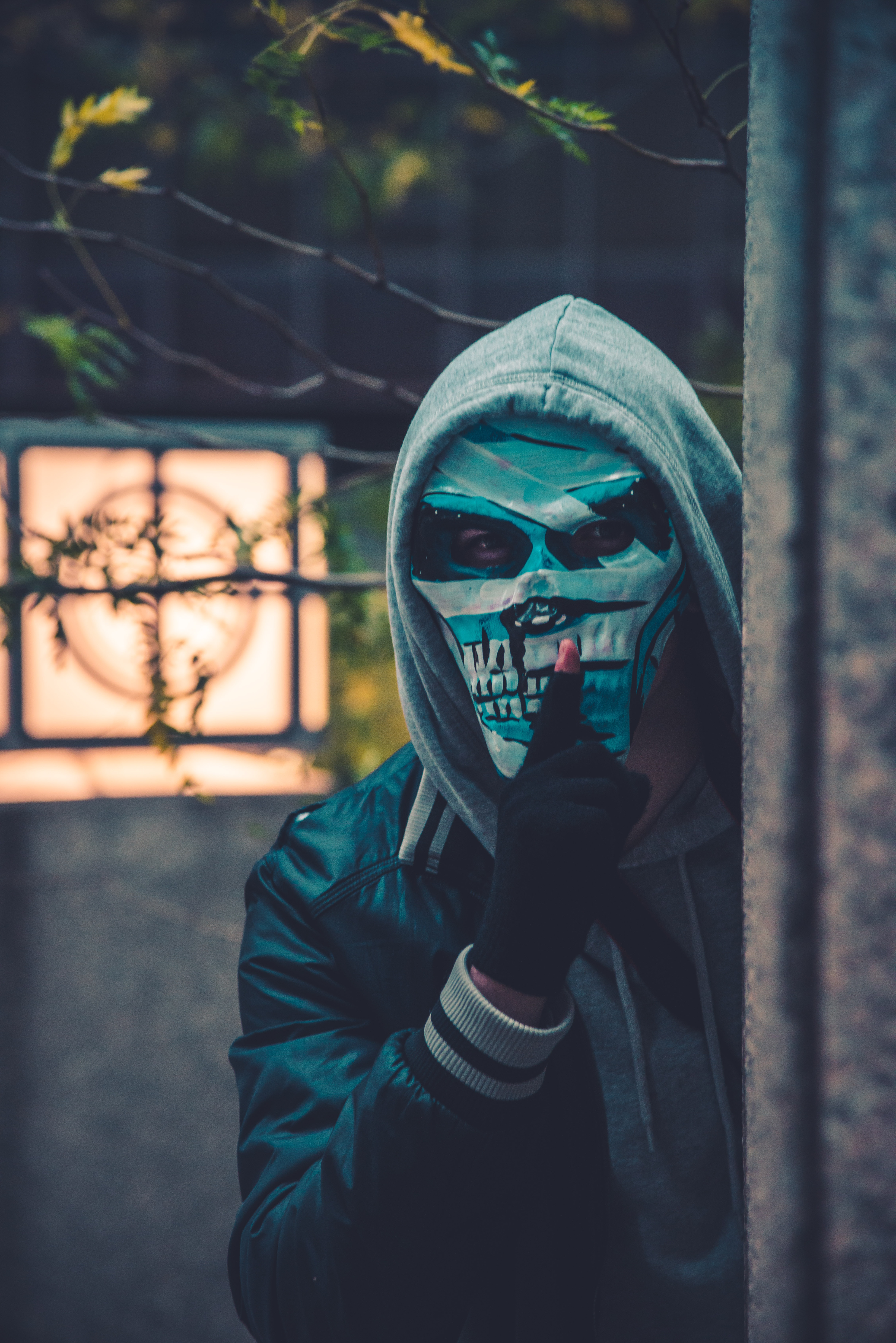 photo of person wearing mask near barbed wire