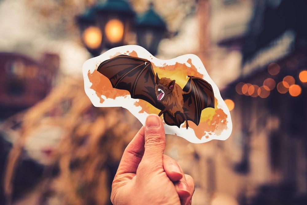 person holding bat sticker