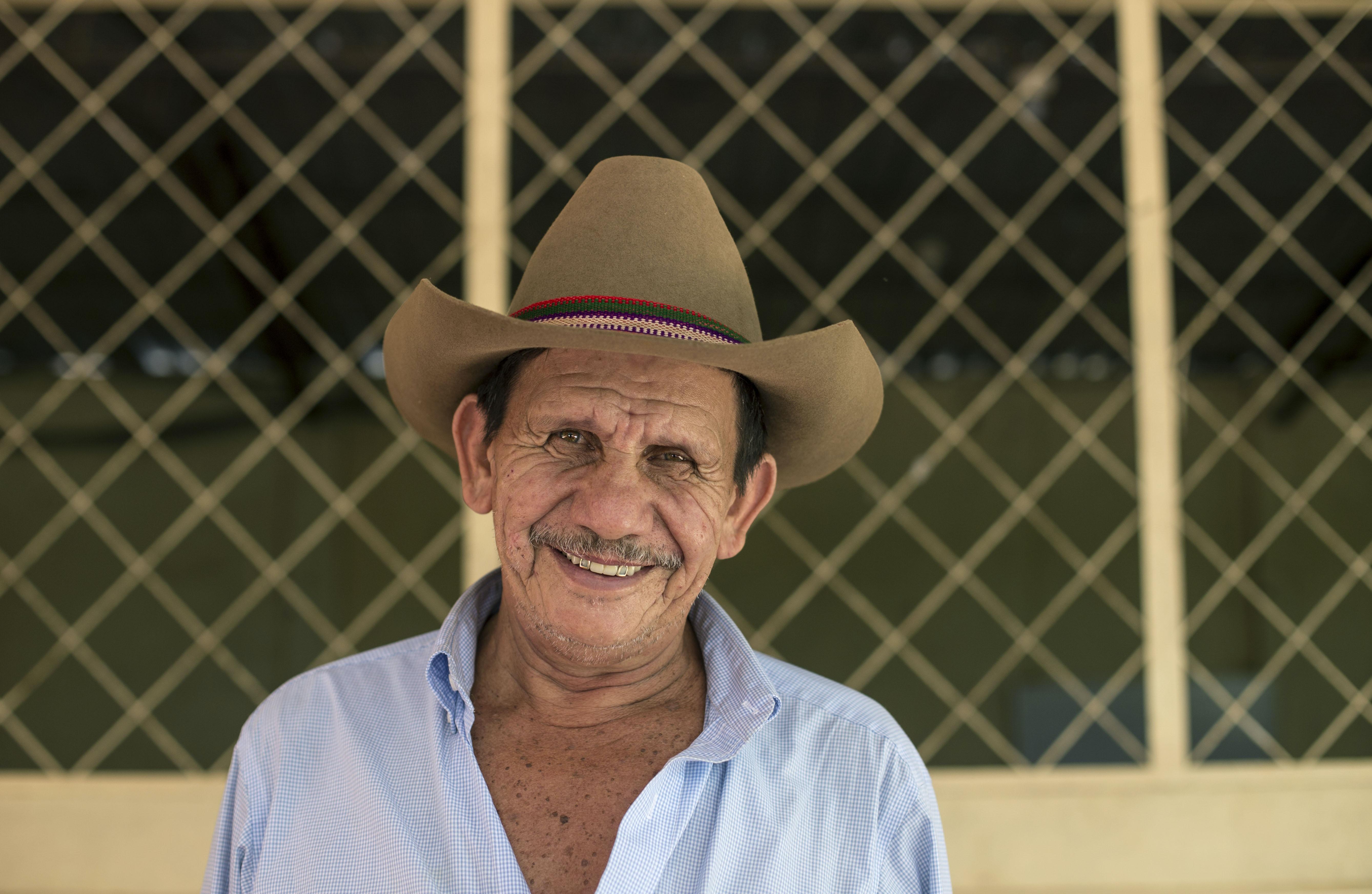man wearing brown cowboy hat
