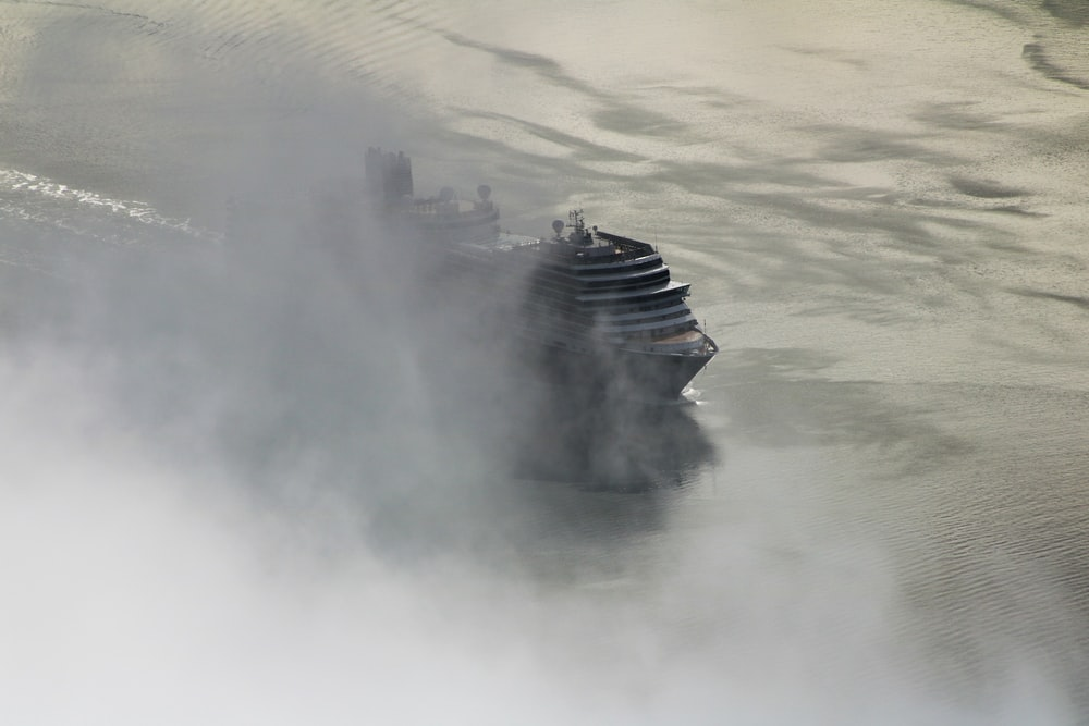 aerial photography of white cruise ship on water under white cloud