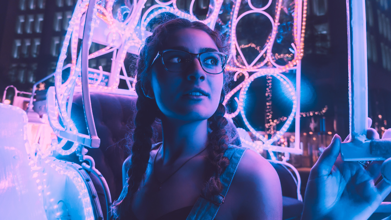 woman wearing black framed eyeglasses riding amusement park ride