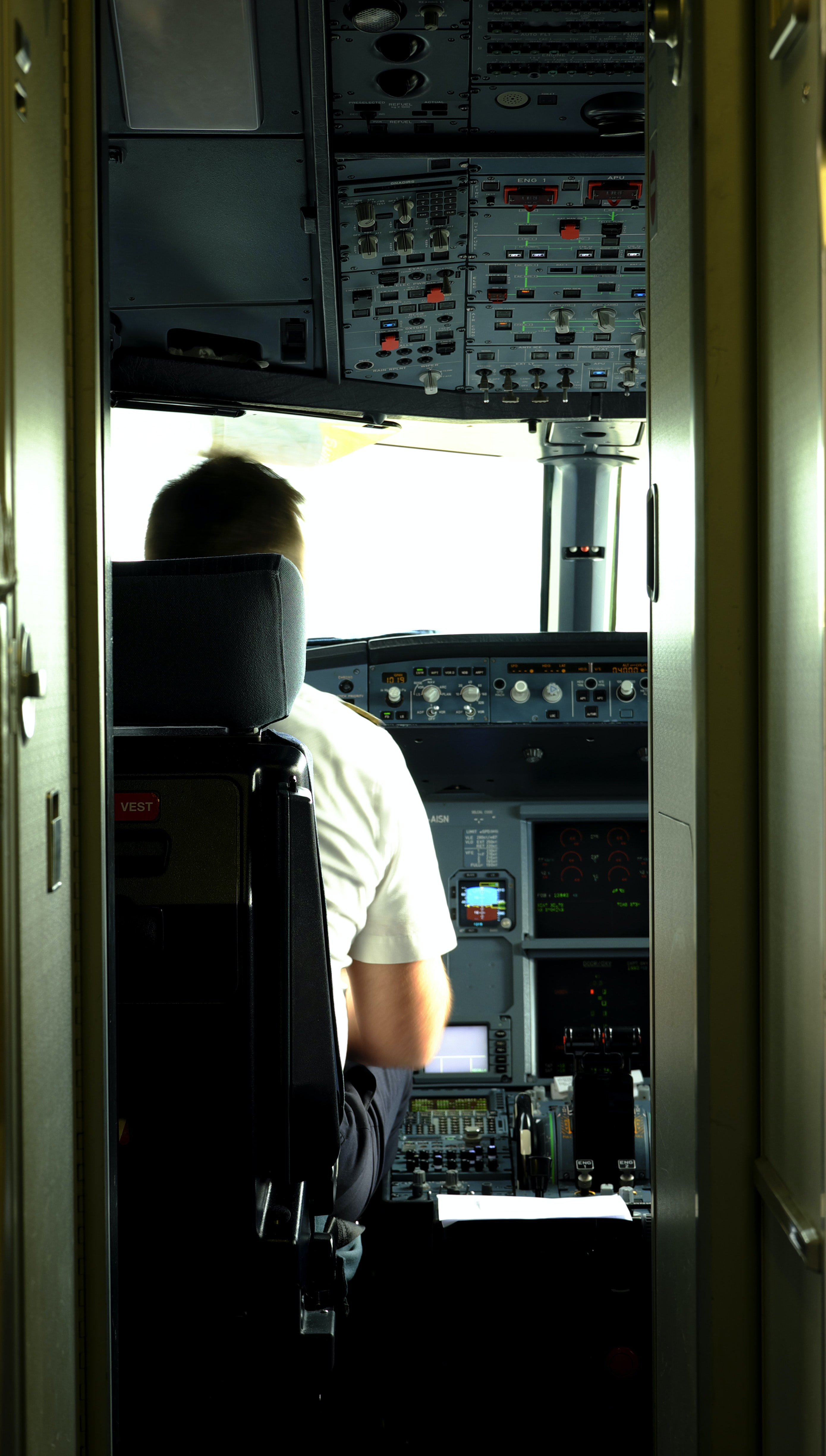 man sitting in front of control panel