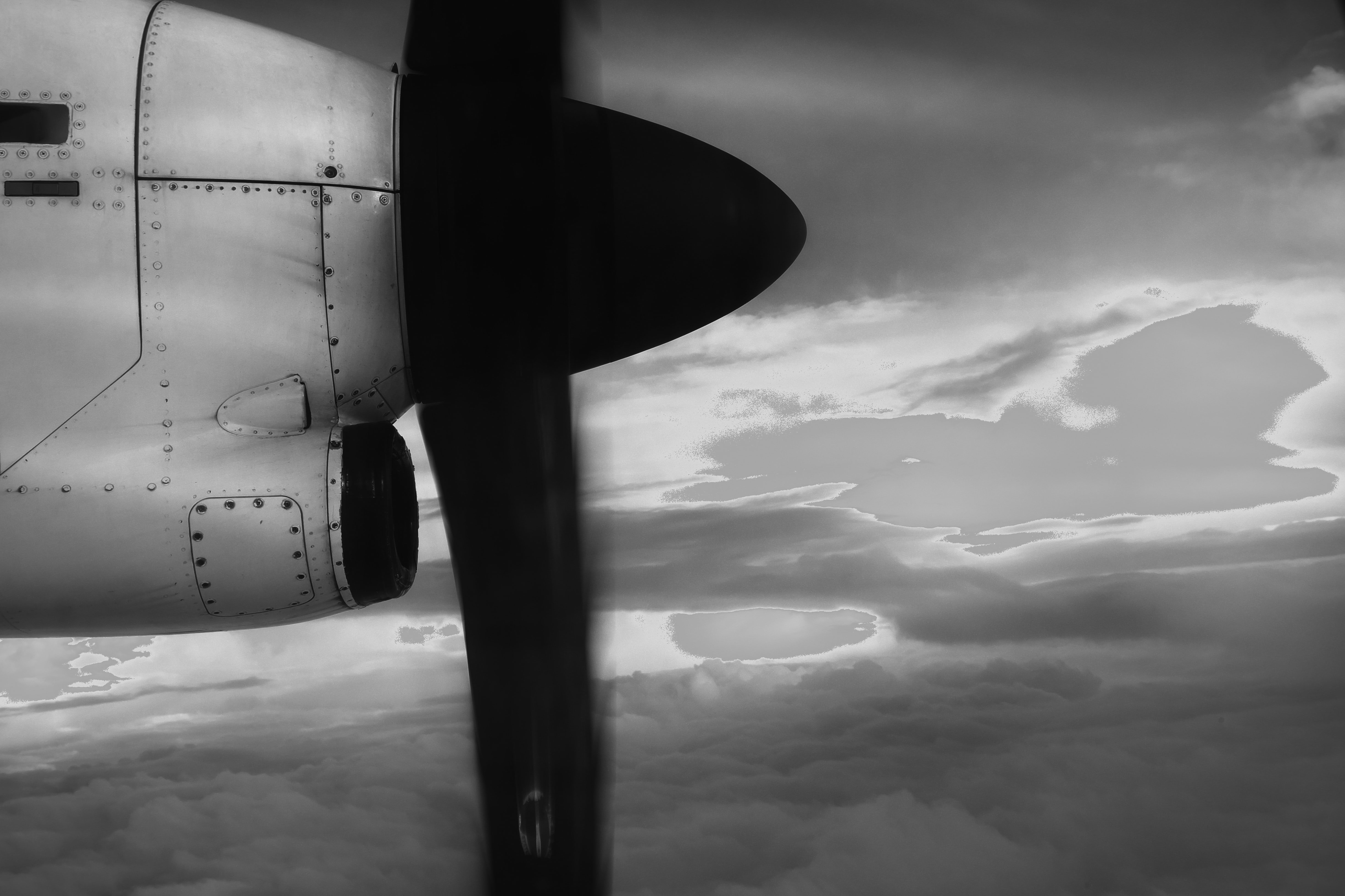grayscale photo of plane propeller