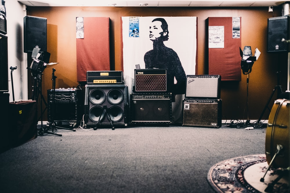 black PA speakers inside room