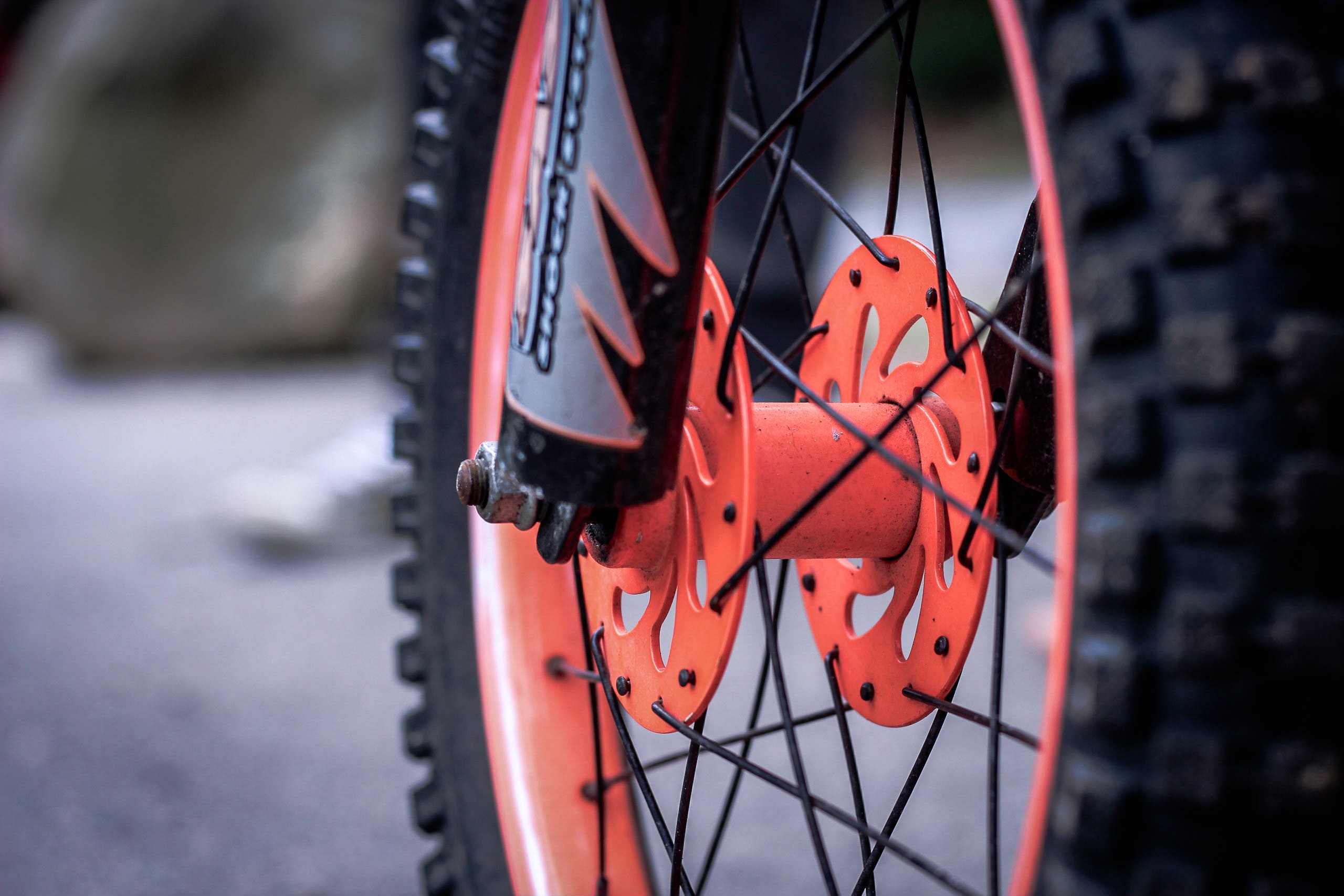 black and orange motorcycle wheel and tire
