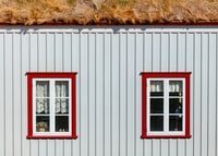 two white wooden window panels